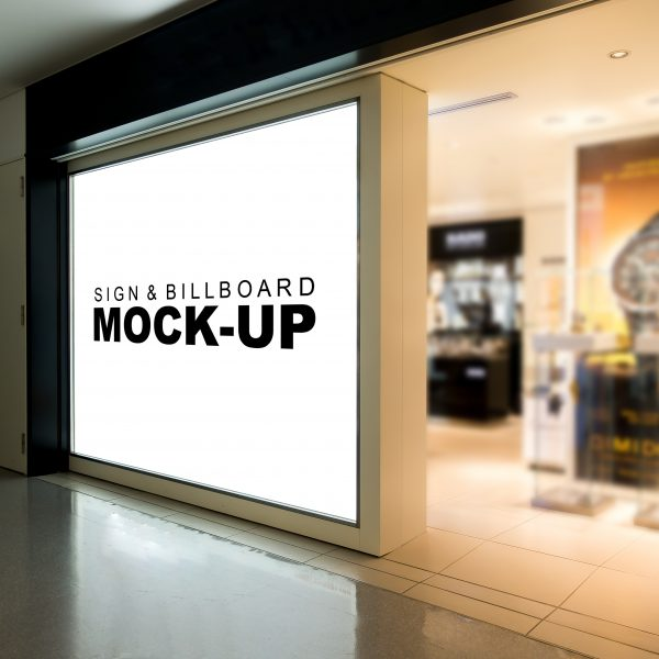 ecran vitrine boutique Mock up large signboard on the glass with clipping path, blank space with white screen for information or promotion advertising billboard, blurry signage in duty free shop